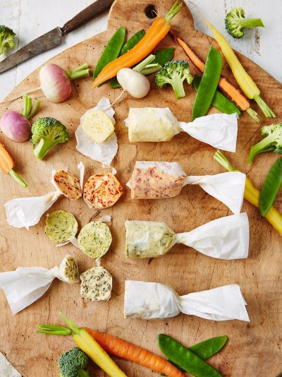 Steamed vegetables with flavored butters